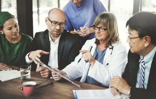 Physicians around the boardroom table